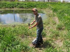 grad student working in wetland