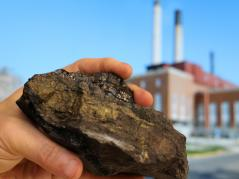 sample of coal with pyrite, power plant in background