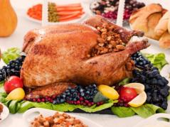 Turkey dinner surrounded by fruit garnish