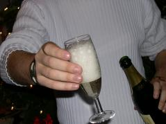 Person offering a glass of champagne