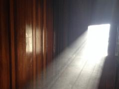 sunlight illuminating dust in a room