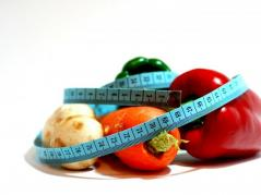 Healthy foods with tape measure