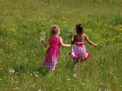 young girls running in a field