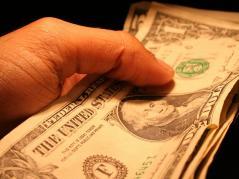 man's hand holding money