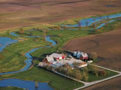 aerial of farm near river