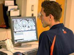 Austin Mudd with MRI images