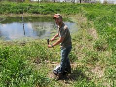 grad student working in wetland