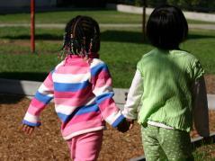 two preschoolers hand-in-hand