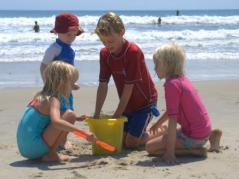 siblings making sand castle