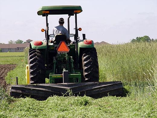 Roller crimper flattening cover crop